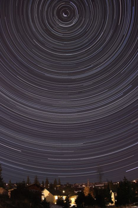 Star trails over a Homer neighborhood by Thomas Kerns of Beluga Lake Observaory